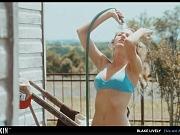 Blake Lively models her perfect body while posing in a black bikini
