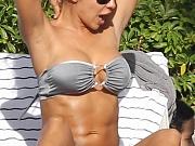 Vida Guerra tanning in thong bikini