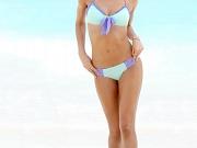 Lily Aldridge posing in tiny bikini