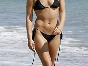 Ali Larter shows pokies in bikini