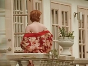 Woman Stands On The Balcony And Hopes For Sex