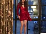 Lily Collins dancing in red dress and high heels