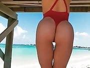 Daniella Chavez with red g-string swimwear